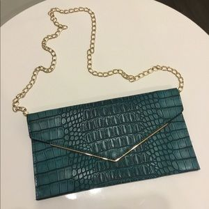Handbags - Turquoise faux crocodile clutch with chain
